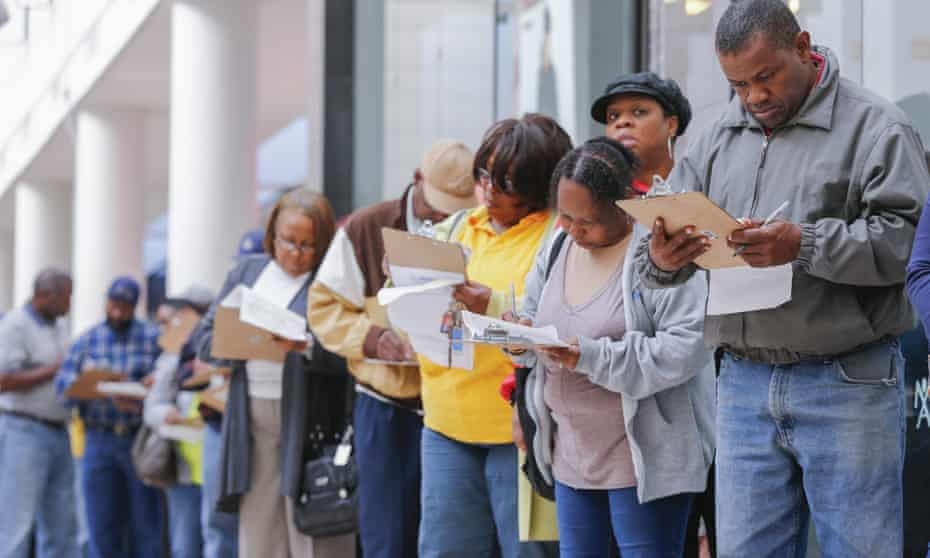 People fill out paperwork while waiting to cast ballots in Georgia.