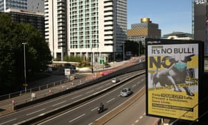 Cars on relatively empty roads today passing a giant advertisement asking people to follow public safety advice in Birmingham, where new local restrictions were announced on Friday.
