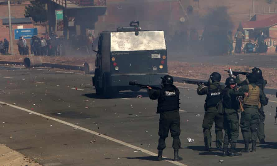 Police clash with miners near a blocked road in Panduro on Thursday as a dispute over industry reform escalated into violence, leaving two workers and now a government minister reportedly dead.