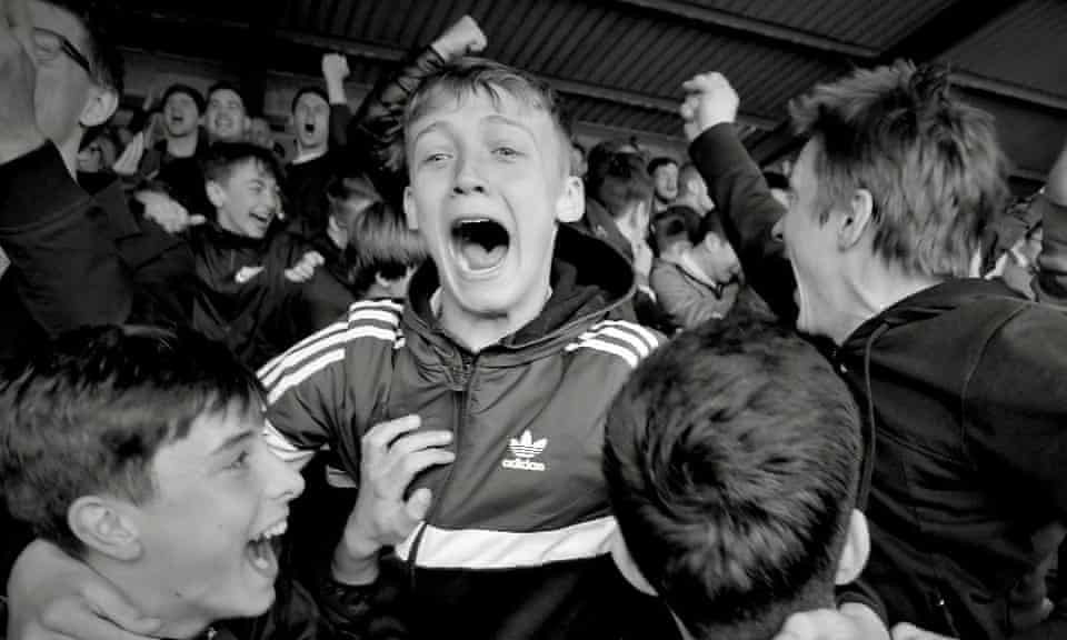 Young York fans celebrate a goal at Bootham Crescent