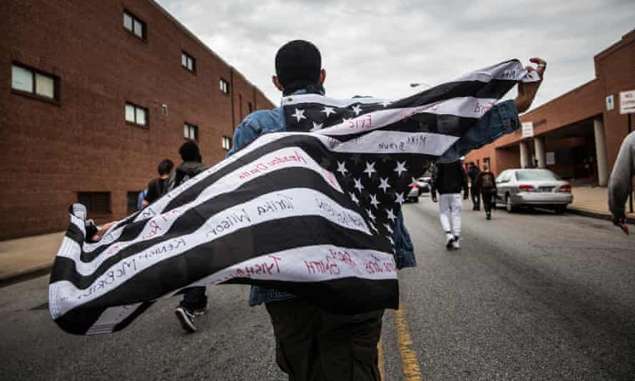 Protesters march through the streets in support of Maryland state attorney Marilyn Mosby's announcement that charges would be filed against Baltimore police officers in the death of Freddie Gray on May 1, 2015 in Baltimore, Maryland. Gray died in police custody after being arrested on April 12, 2015.