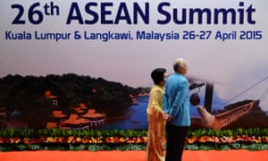 Najib Razak, the prime minister of Malaysian, right, and his wife, Rosmah Mansor, wait for a group photo on Sunday before a gala dinner in honour of visiting leaders from the Association of Southeast Asian Nations.