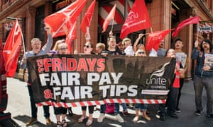Staff from TGI Fridays demonstrate in Covent Garden, central London