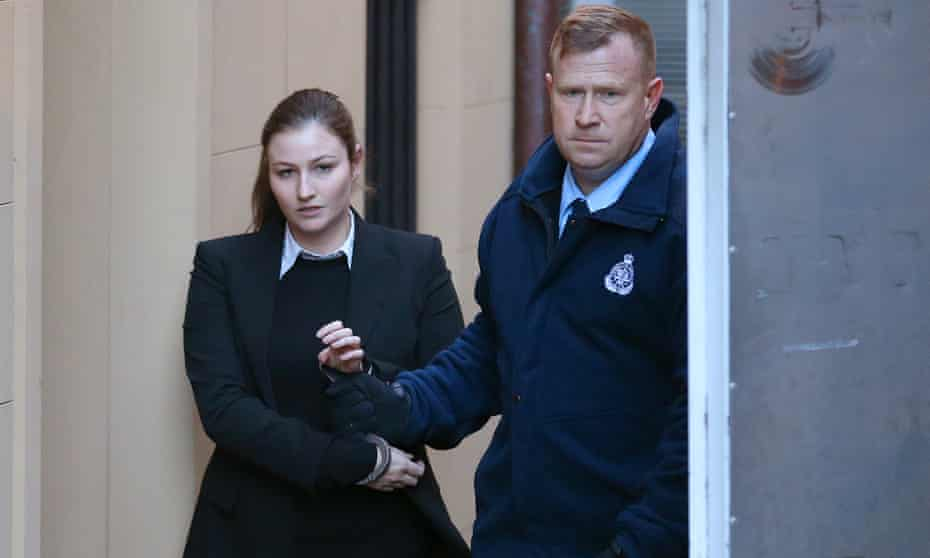 Harriet Wran is led to a waiting prison services vehicle at the NSW supreme court in Sydney