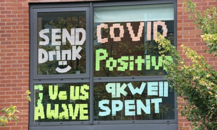 Protest signs on a window of a university hall of residence in Manchester
