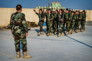 On the move: Khider drills her troops at their base in Snuny in Sinjar province.