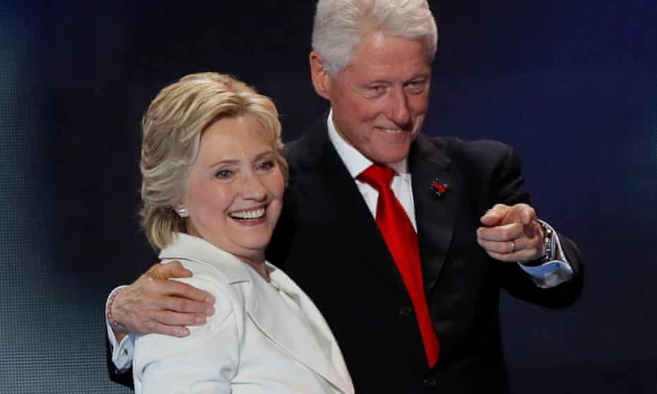 Hillary Clinton stands with her husband Bill Clinton