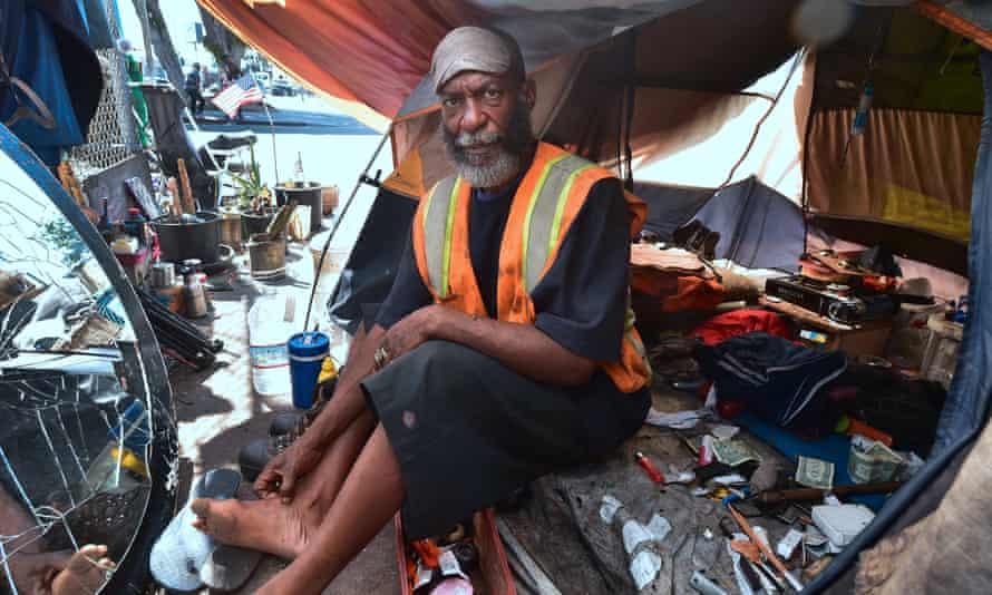Kendrick Bailey, a homeless veteran, keeps cool inside his tent on a street corner near Skid Row in 2017.