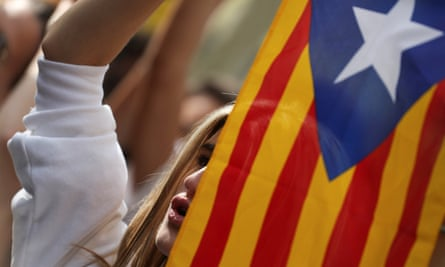 A demonstrator holds up a Catalan separatist flag in Barcelona