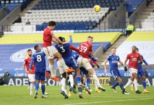 Manchester United's Harry Maguire heads at goal.