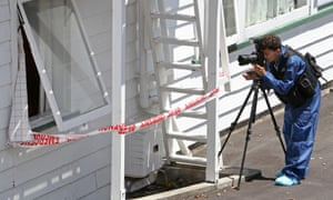 A police photographer at the scene of an assault in auckland new zealand