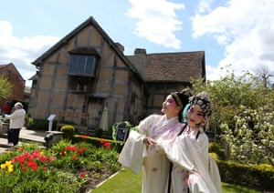 Chinese artists perform in the garden of William Shakespeare's birthplace during events marking the 400th anniversary of his death