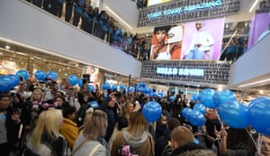 Customers arriving at the grand opening of the worlds largest Primark store in Birmingham, England.