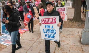 Workers march in favour of a minimum wage in Washington DC