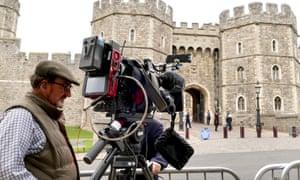 A cameraman outside Windsor Castle