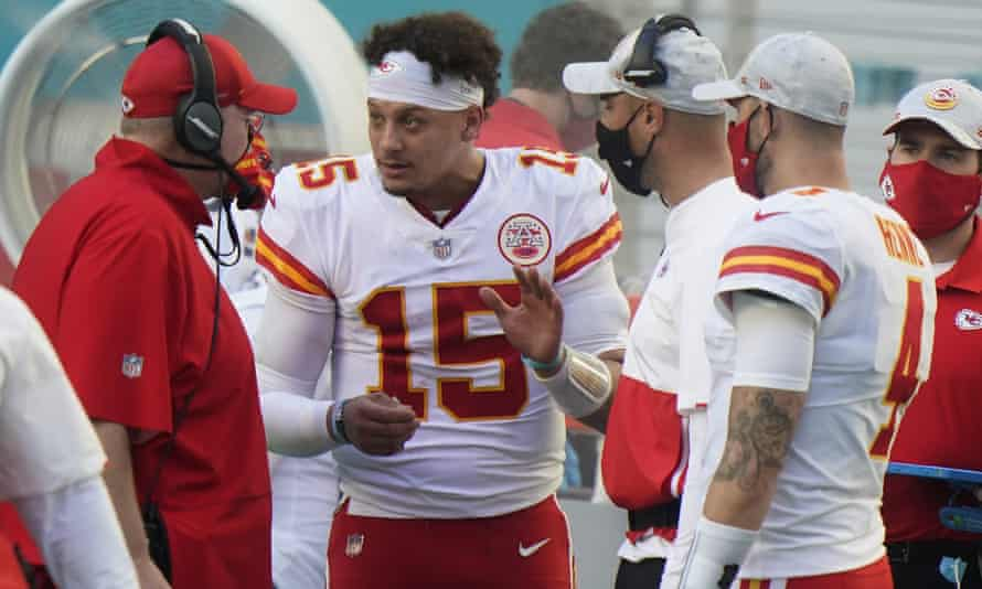 Patrick Mahomes talks to Chiefs head coach Andy Reid on the sidelines during Sunday's game