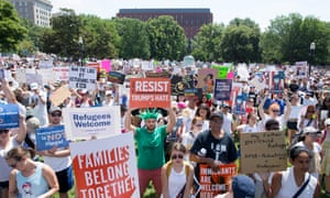 Thousands of people attend a 'Families Belong Together' rally at Lafayette Park across the street from the White House in Washington on Saturday.
