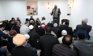 Iman Mufti Abdur Rahman Mangera speaks to members of devotees in Stornoway as they attend the official opening of the mosque.