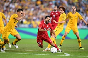 Mohamad Haidar of Lebanon is tackled by Mustafa Amini of the Socceroos during the International friendly match between Australia and Lebanon at ANZ Stadium in Sydney.