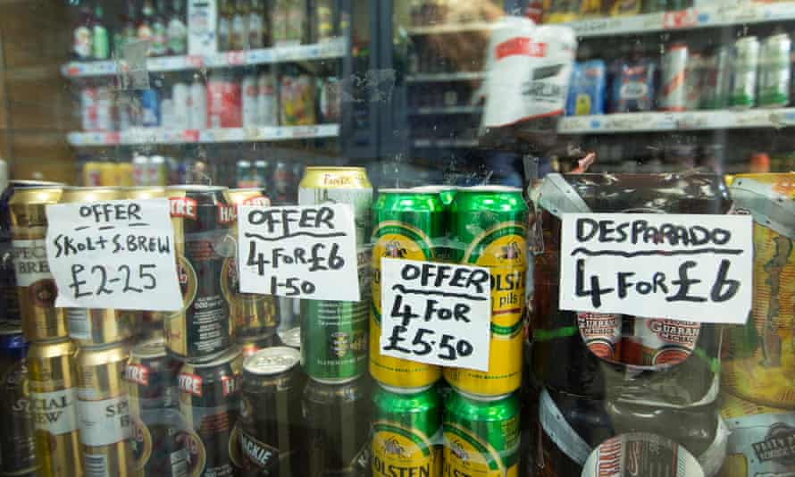 Alcoholic drinks are advertised at an off-licence.
