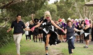 Alex Greenwich, Joyce Maynge and Labor councillor Linda Scott lead the start of the annual Little Black Dress run