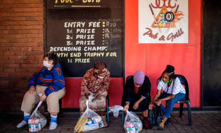 People check food parcels from Meals on Wheels in Brapkan, Gauteng province, near Johannesburg.