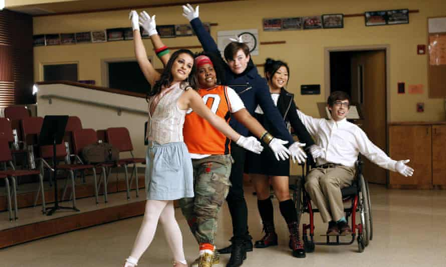 Make a song and dance about it ... Chris Colfer (centre) as Kurt Hummel in Glee.
