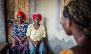 'Mariatu', 16, seen here facing two soweis, has bravely refused to undergo female genital mutilation.