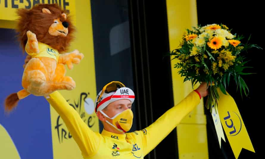Tadej Pogacar celebrates taking the yellow jersey after winning the 20th stage of the Tour de France, a 36km time trial between Lure and La Planche des Belles Filles
