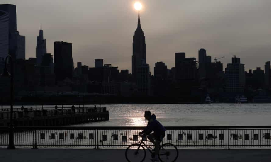 The sun rises behind the Empire State Building in New York City in a haze created by smoke from the west coast wildfires, 15 September 2020.