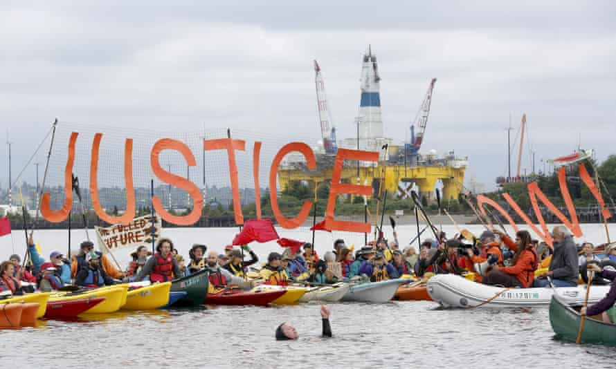 Activists protest the Shell Oil Company's drilling rig Polar Pioneer which is parked at Terminal 5 at the Port of Seattle.