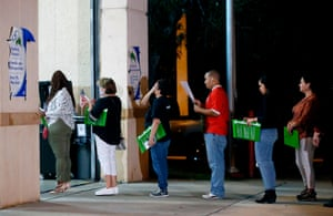 People wait in line to vote at a polling station in Miami, Florida, late on November 6, 2018.
