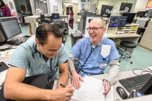 Drs Manu Malhotra and Gerald Martin joke around during a shift in the emergency room.