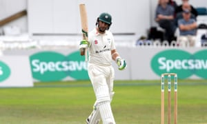 Worcestershire's Daryll Mitchell raises his bat after his half century.