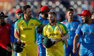 Australia's Glenn Maxwell, left, Australia's David Warner, centre, and Afghanistan's captain Gulbadin Naib leave the field.