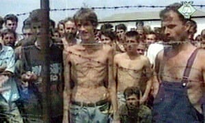 Fikret Alić , centre, and other prisoners in the Trnopolje internment camp where Muslims and Croats were held.