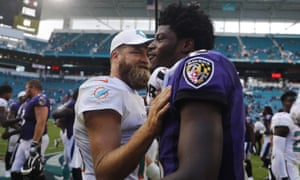 Lamar Jackson is congratulated by his opposite number Ryan Fitzpatrick at the end of the Ravens-Dolphins game