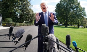 Donald Trump speaks to journalists outside the White House