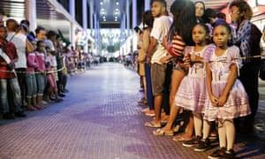 Brazilians wait for the torch arrival in Rio's North Zone.