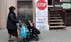 A sign warning people of measles in the ultra-Orthodox Jewish community of Williamsburg, after New York City's Mayor Bill de Blasio declared a public health emergency in parts of Brooklyn.