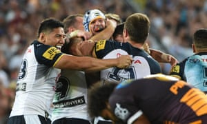 Cowboys co-captain Johnathan Thurston is mobbed by Cowboys' team-mates.
