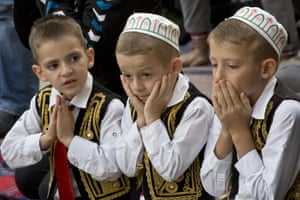 Pristina, Kosovo: Children attend Eid al-Adha prayers