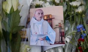 A photo of slain priest Jacques Hamel at a memorial at the Saint-Etienne-du-Rouvray city hall, near Rouen, France