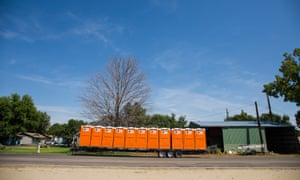 A trailer full of portable toilets waits to be unloaded in Weiser, Idaho. The rural town is preparing for crowds coming to see next week's total eclipse.