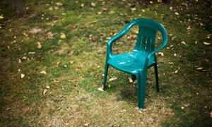 AXA20J Child s small plastic chair on lawn