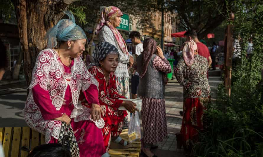 Uighur women wearing traditional clothes in Kashgar, in the north-western province of Xinjang where nearly 10 million Muslim Uighurs live.