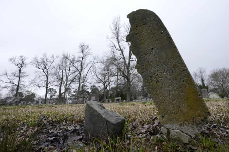 A deteriorating tombstone is close to collapse at the Lincoln memorial cemetery in Portsmouth, Virginia, in March. Many Black Americans excluded from white-owned cemeteries built their own burial spaces, and their descendants are working to preserve the grounds.