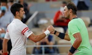 Novak Djokovic shakes hands with Rafael Nadal.
