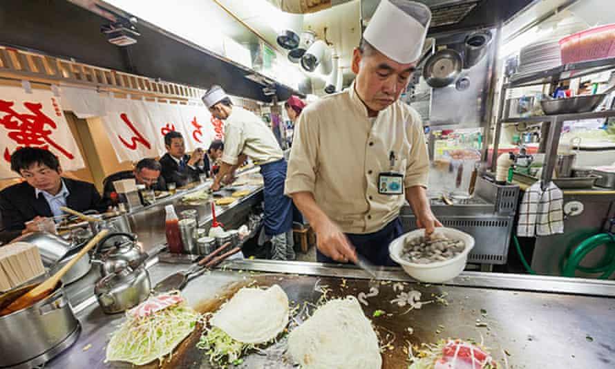 Shrimps, pork and beansprouts on Kansai-style okonomiyaki.