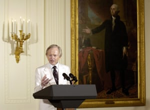 Tom Wolfe makes an address during an event in the East Room of the White House in March 2004